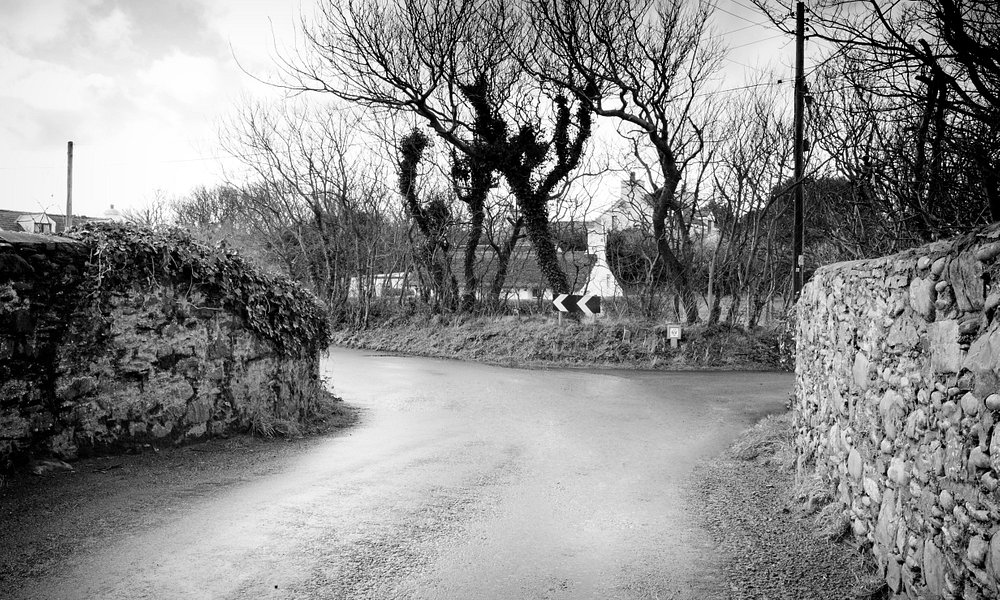 View from the Lhen Bridge to Yn Thie Thooit, a traditionally thatched Manx cottage at The Lhen,