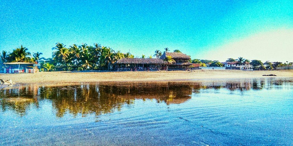 The beautiful rooms at Dulce Mareas, the view from the restaurant at sunrise, and sunset on the