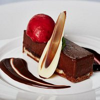 Dark chocolate torte, chocolate sauce, raspberry sauce, raspberry sorbet
