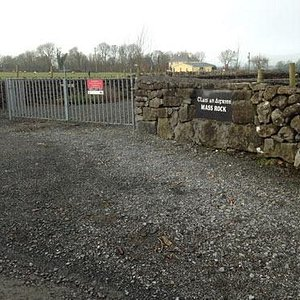 The entrance and parking area at the Mass Rock garden in Sylane