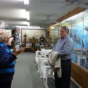 Docent and guest at wall display showing life-size fish and major underwater topographic feature