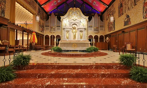 View of altar from center aisle at rail
