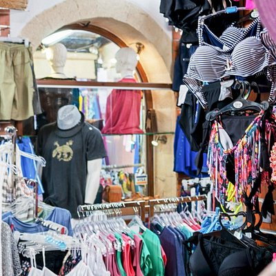 In our shop you can find a wide selection of  quality t-shirts bikini and dresses!