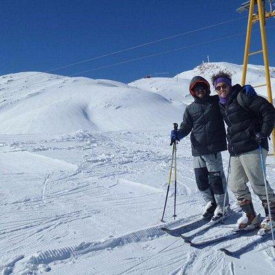 Mr Raesi & myself skiing at Pooladkaf