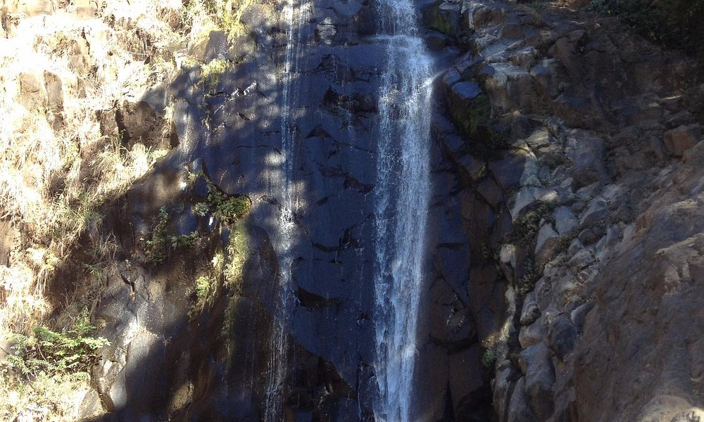 Final waterfall on 7 Cascadas Hike in Parque Imposible. Don't worry you don't jump the entire th