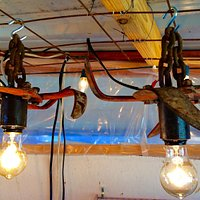 Vintage farm equipment turned into a light.