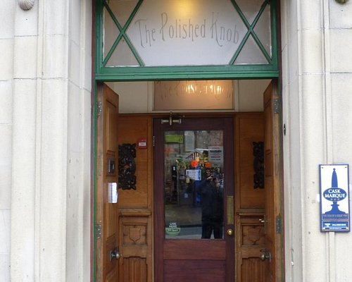 The front door entrance to the Polished Knob name in glass