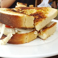 Toasted chicken sandwich with cheese, onion & tomatoe