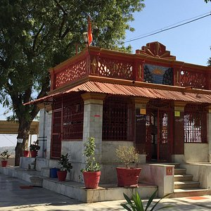 small temple on top of mountain with garden.