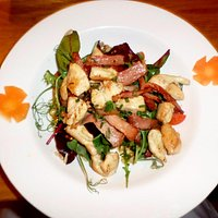 Warm Chicken & Bacon salad with Walnut oil dressing and pine nuts