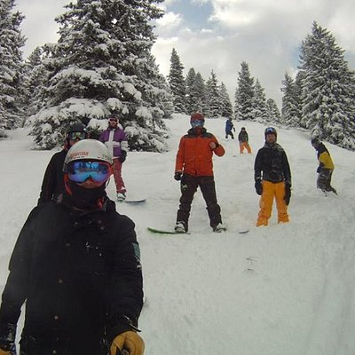 Coaching snowboarding in the trees on our winter camps