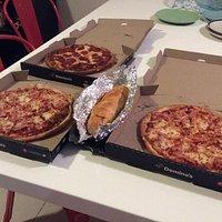 Three $5 pizzas and a $4.95 garlic bread