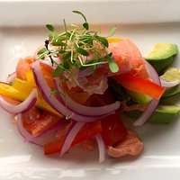 Peruvian salmon ceviche with lime, tequila and avocado
