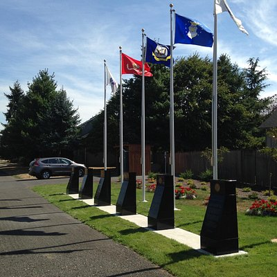 Branch of service flags with granite descriptive markers...