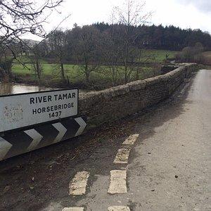 Road sign on pub end of eponymous bridge