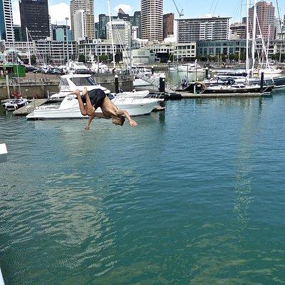 Boys jumping of the Bridge