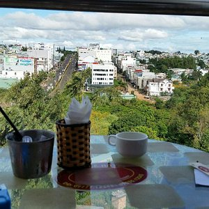Top floor morning coffee with city view