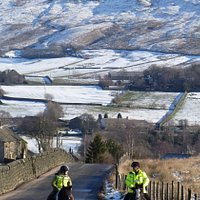 PBW riders, looking down road towards Lumbutts on winters day