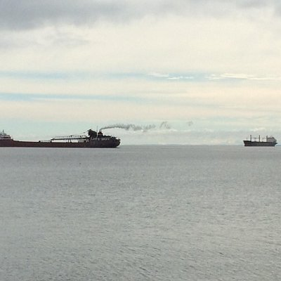 A laker and a salty share in Lake Superior commerce. Taken from near Spirit of the North gift sh