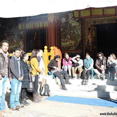Our guide Sange, Describing about the Tawang Monastery to the clients from Germany.