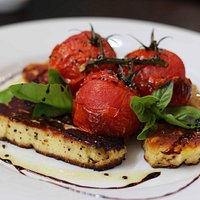 Grilled Haloumi with blistered cherry tomatoes and stick balsamic