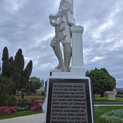 Left of statue