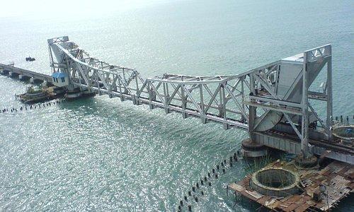 Its Pamban bridge and it wil be thrill to cross this bridge thru train