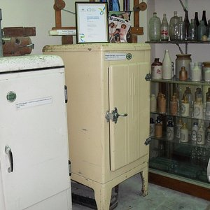 old fridges (ice boxes) and assorted bottles from the past