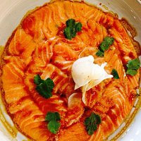 Cromesquis de cabillaud fumé Carpaccio de saumon Risotto vialone nano au tartuffon Mignon de por