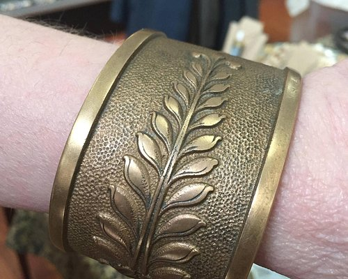 This shop carries treasures like this massive bronze bracelet made from an old cash register!