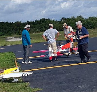Getting ready to take off. Radio-controlled planes on the runway West Delray Regional by B.Ivers