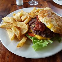 Amazing beef burger with bacon and cheese. The chips are amazing little roasties and nice tastin