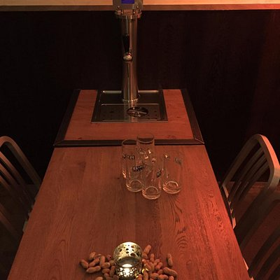 Beer tap at every table + free peanuts