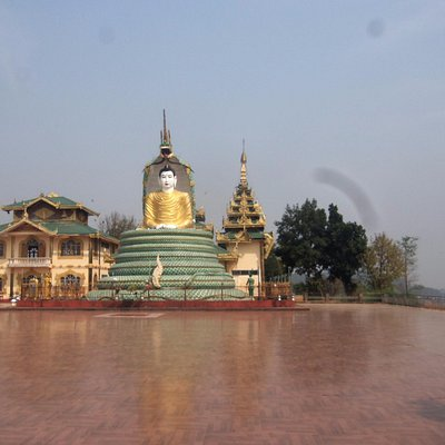 The giant Buddha in the temple grounds showing the Buddha sitting on the coiled snake.