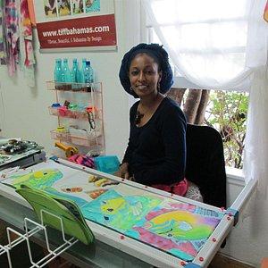 An artist at work in the Graycliff Heritage Artist Studios