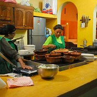 Open air kitchen facing the sidewalk at Taqueria Los Arbolitos