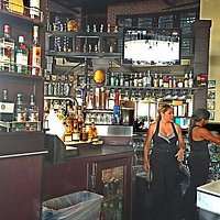 The bar is very large and well-equipped with staff, beverages and TVs