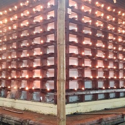 thousands of lamps on the temple wall