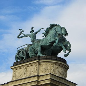 Man with a snake-symbol of War - Heroes' Square