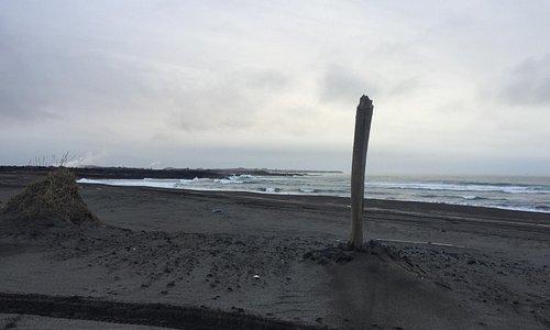 Sandvik, black sandy beach