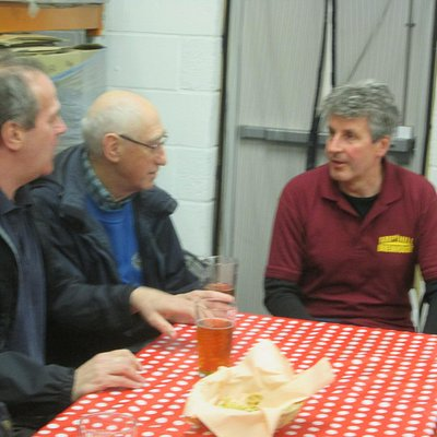 Peter chatting with two visitors