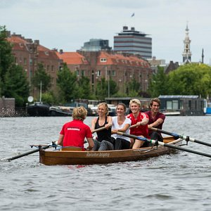 Unique experience of rowing the river Amstel and the canals in the old town centre of Amsterdam