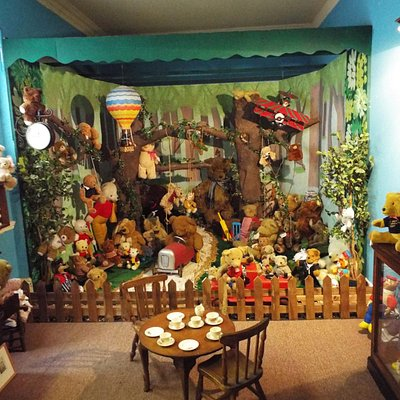 100's of teddy bears all having fun in the forest