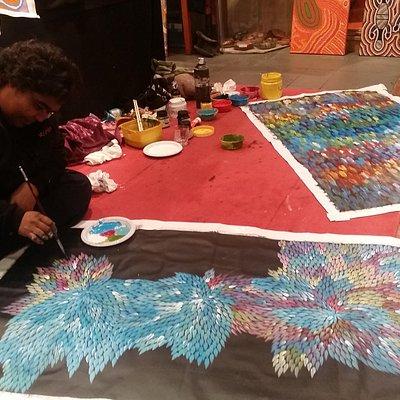 "Bernadine Johnson painting ""Medicine Leaves"" in Gallery"