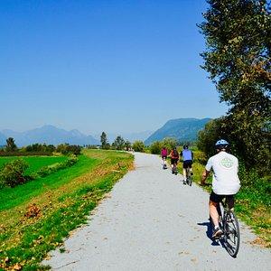 Pedaling along the Trans Canada Trail at Pitt Meadows, BC