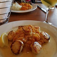 Scallops over butternut squast with utterly tasteless sauce surrounding the scallops. What was t
