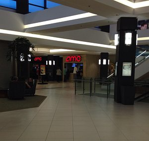 The AMC theater is located in a strip mall with a ton of restaurant options and some nice seatin