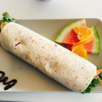 Wrap with goat cheese, vegetables, yogurt sauce and season fruits.