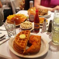 Smothered chichen with waffels, fried chicken with waffels, angus hambugher with fried potatoes