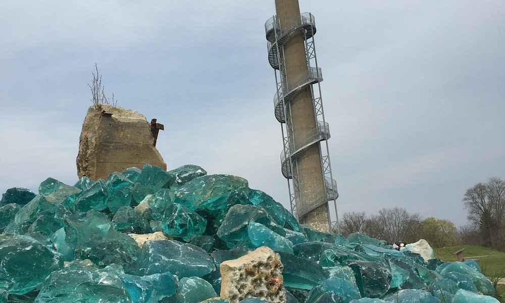 Blue-green glass exhibit in front of the smoke-stack tower - you can climb it!